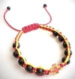 Браслет (137) плетеный желтый с красным, с крестом